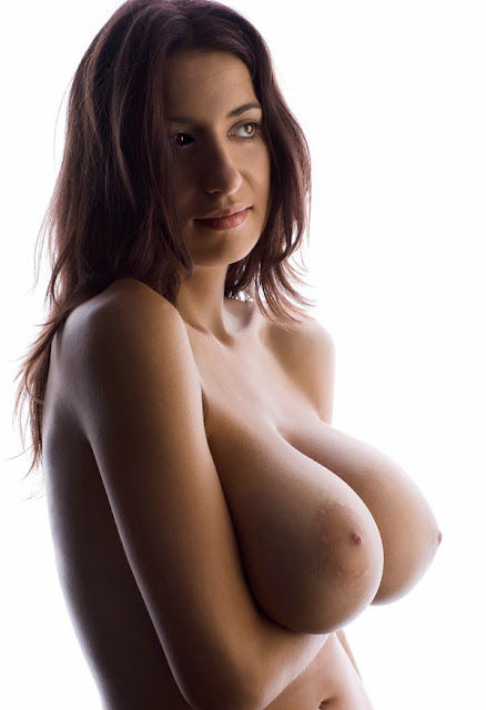 Brunette hoists up her massive boobs; Ass Big Tits Brunette