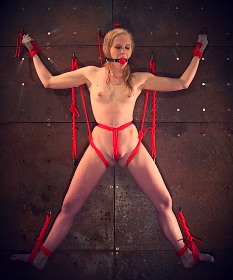 Blonde slave bound to a wall; Blonde Bondage Fetish