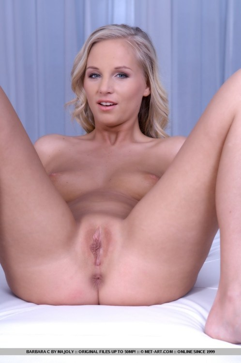 Blonde spreading shaved pussy