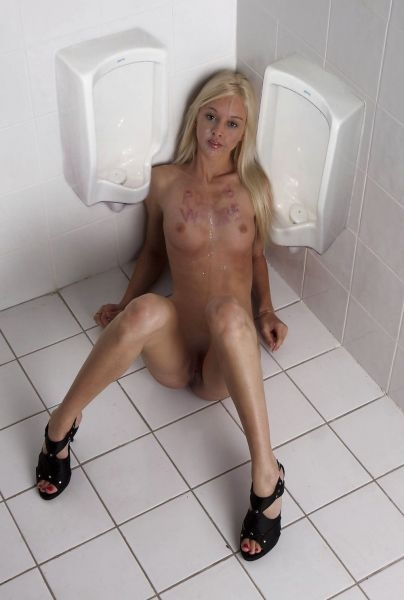Very cute blonde between two urinals; Blonde Fetish