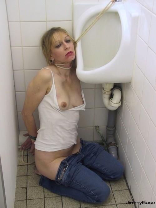 Roped near urinal; Fetish